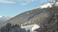 Exterior wide shots of snow capped mountain range at Davos Klosters and the spire of St John's church on January 22 2015 in Davos Switzerland