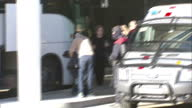 Exterior wide shots Spanish relatives of Germanwings plane crash victims arriving at Barcelona airport stepping off bus and walking towards terminal...