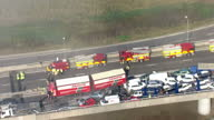 exteriors aerials line of cars piled up into each other after crash with emergency services vehicles parked on opposite side of the road car with...