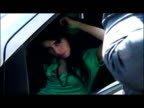 exteriors Amy Winehouse fixing hair talking on moblie phone while sitting in car exteriors Amy Winehouse drives into police station gets out of car