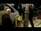 Exteriors Amy Winehouse walks from car into Holborn Police Station with crowd of press onlookers outside