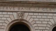 Exteriors and signage shots of the Federal Reserve Bank Building in Cleveland Ohio Close up shots of two stone statues outside the main entrance to...