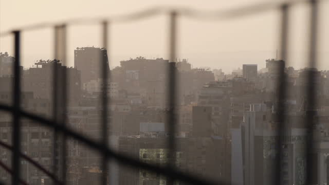 Exteriors of Cairo city skyline buildings with haze in the air on January 28 2015 in Cairo Egypt