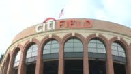 Exteriors of Citi Field Stadium generic game day shots crowds in the bleachers people buying ticketspeople going through turnstiles food vendors...