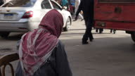 Exteriors of pedestrians and vehicles on quiet back streets in Cairo on January 29 2015 in Cairo Egypt