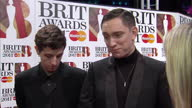 Exteriors The XX members Romy Madley Croft Oliver Sim and Jamie Smith being interviewed on red carpet by Sky News reporter Lucy Cotter Brit Awards...