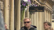 External generic stock shot The Pump Room restaurant entrance sign in Church Street Bath town centre various people past on cloudy weather day in...