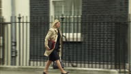 External shot Mary Macleod Conservative MP walks into 10 Downing Street as security guard leaves building in London England on Tuesday 14th March 2017