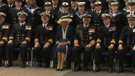 External shot pan of Navy Ranks stood together waiting for arrival of Royals Prince Charles Prince of Wales Camilla Duchess of Cornwall arrive walk...