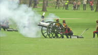 External shots of gunners from the King's Troop Royal Horse Artillery firing salute for the Queen's Birthday in Green Park 41 Gun Salute for The...