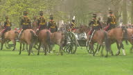 External shots of gunners from the King's Troop Royal Horse Artillery riding into Green Park to perform 41 gun salute for the Queen's 87th birthday...