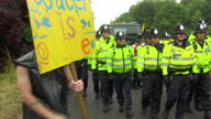 External shots of police officers escorting a lorry past an antifracking protest camp outside a shale gas exploratory drilling site near the village...