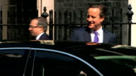 external shots of Prime Minister David Cameron exiting number 10 getting into car and departing Downing Street on day of Conservative Cabinet...