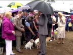 External shots of Prince Charles and Camilla Duchess of Cornwall meeting members of the public and patting dogs at Sandringham Flower Show in the...