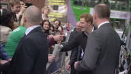 External shots of Prince Harry departing from the Confetti Institute of Creative Technologies talking to officials and going over briefly to speak to...