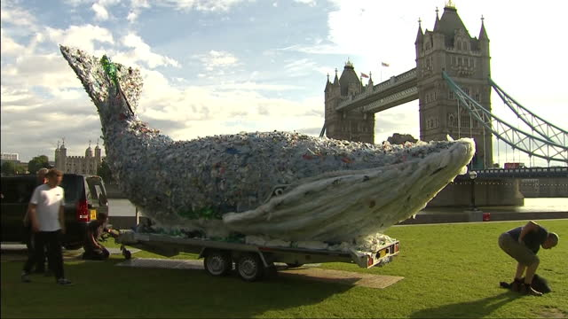 External shots of tenmetre plastic whale made of 250 kilograms of singleuse plastic with view of London Bridge in background installation art piece...