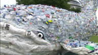 External shots of tenmetre plastic whale made of 250 kilograms of singleuse plastic close up shots of used empty plastic bottles straws etc and other...