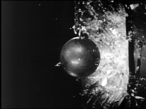 B/W HIGH SPEED extreme close up lead ball smashing into television screen