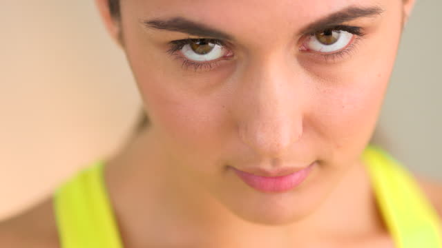 Extreme close up of serious woman looking up at camera