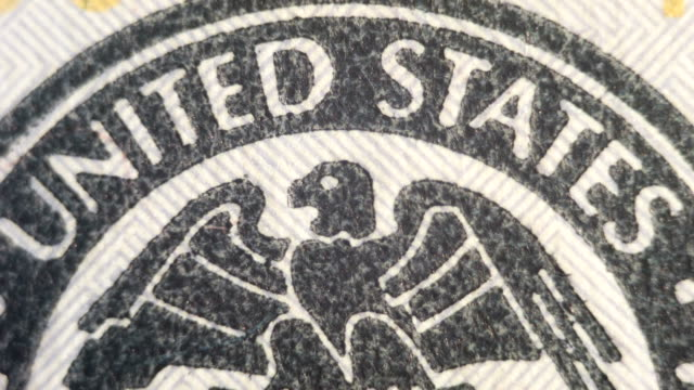 Extreme close up of the Federal Reserve System symbol on the $100 bill