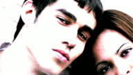 OVEREXPOSED extreme close up PAN PORTRAIT teen couple looking at camera
