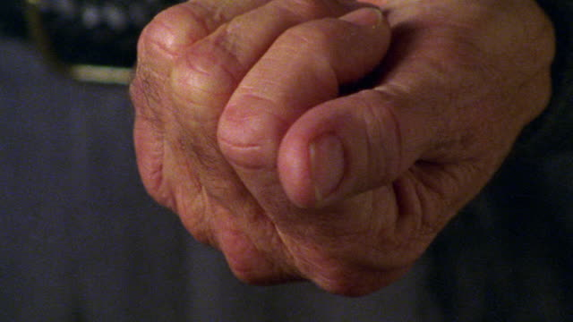 extreme close up senior man's hand opening + revealing pill