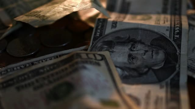 Extreme Close up shots of ten and twenty US dollar bills arranged for a photo shoot on June 19th 2015 Shots 10 and 20 dollar bills are loosely...