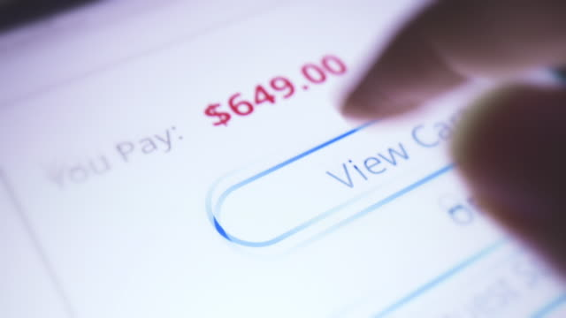 Extreme close-up of online shopping with digital tablet