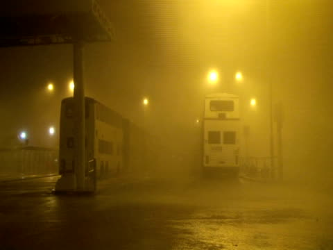 Extreme hurricane wind rain lashing buses in station, Typhoon Koppu, Hong Kong on night of 14th sept 2009. With Audio.
