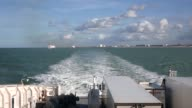 Extreme Long Shot a 'PO' crosschannel ferry docked in the port of Calais seen from a departing ferry on October 30 2013 in Calais France