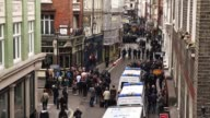 Extreme long shot of Beak Street Police are seen on Beak Street where anti G8 protesters had occupied a building on June 11 2013 in London England...