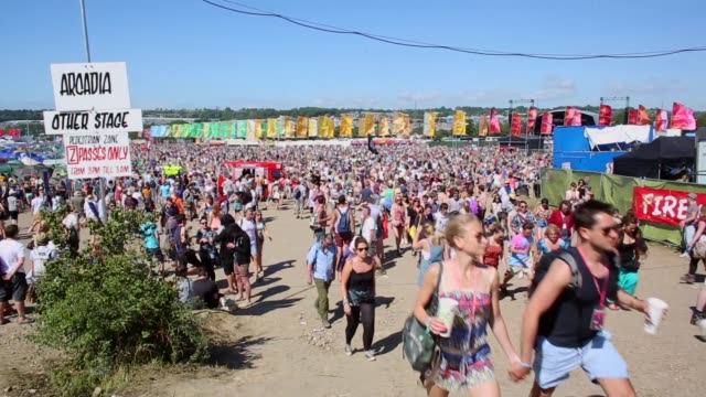 Extreme long shot of people walking around the festival site