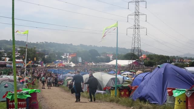 Extreme long shot of tents and festival venue