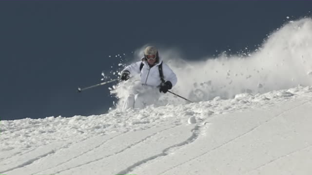 MS PAN Extreme skier skiing through exploding Powder Snow / Telluride, Colorado, United States