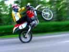 Extreme sport. Motorbike race on the back wheel