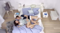 extremely good looking love couple in bedroom - enjoying time together