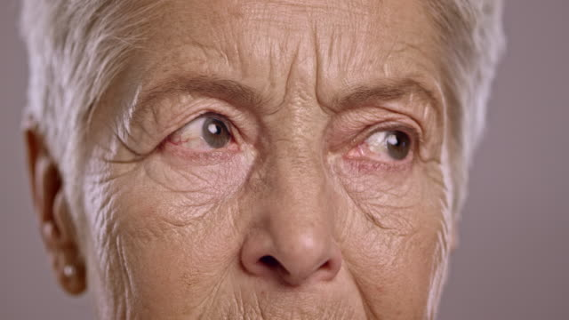 Eyes of a senior Caucasian woman looking around