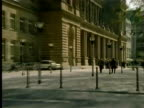 1994 MONTAGE WS ZI Fa�ade of Frankfurt Stock Exchange and Chamber of Commerce building/ WS TU Businessman and woman entering the building/ Frankfurt am Main, Germany/ AUDIO