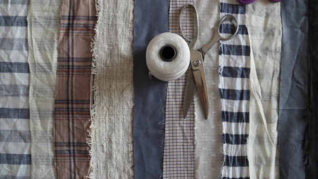 Fabric swatches on a tailor table