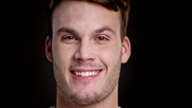 Face of a smiling young Caucasian man