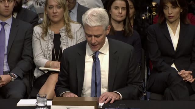Facebook Vice President and General Counsel Colin Stretch reads a prepared statement at a hearing on mitigating foreign interference in United States...