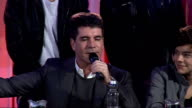 'X Factor' press conference Simon Cowell press conference SOT Has been working hard with One Direction doesn't think his act has suffered because he...