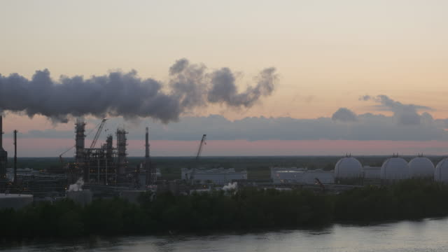 Factories spread out along the Mississippi river outside the city of New Orleans USA