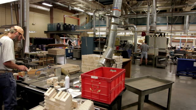 WS PAN Factory floor, man sorting small wood pieces / Nazareth, Pennsylvania, USA