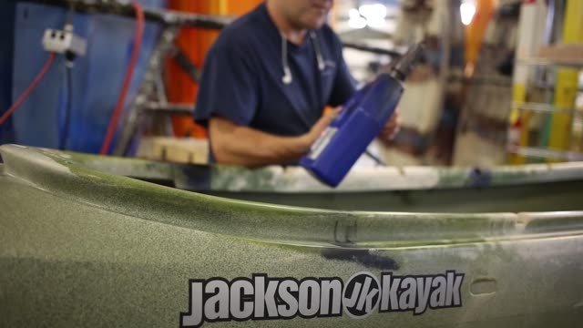 Factory workers install hardware onto plastic kayaks at the Jackson Kayak Inc factory in Sparta Tennessee US on Wednesday Oct 4 Photographer Luke...