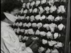 Factory workers manufacture penicillin in a pharmaceutical factory