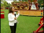 Fairground plays Cliff Richard to deter hoodies ENGLAND London Dulwich Belair Park EXT Reporter to camera Fairground rides at amusement park PAN to...