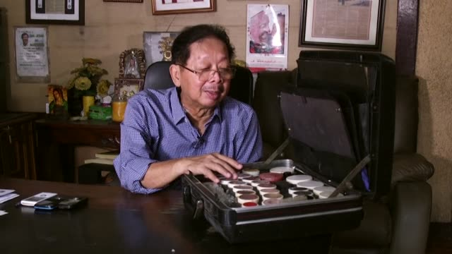 Fake hair and a waxen mask hid Ferdinand Marcos's disease ravaged corpse as it became a major Philippine tourist draw for 20 plus years the ex...