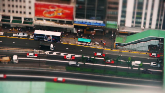 Fake Miniature shot of Traffic in Hong Kong Island - seen from High Rise Building
