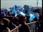 Argentinian prisoners ARGENTINA Buenos Aires TS Commandeered ferry LR MS Ferry turning MS Ticker tapes falling PAN to harbour CMS Crowd wave flags MS...